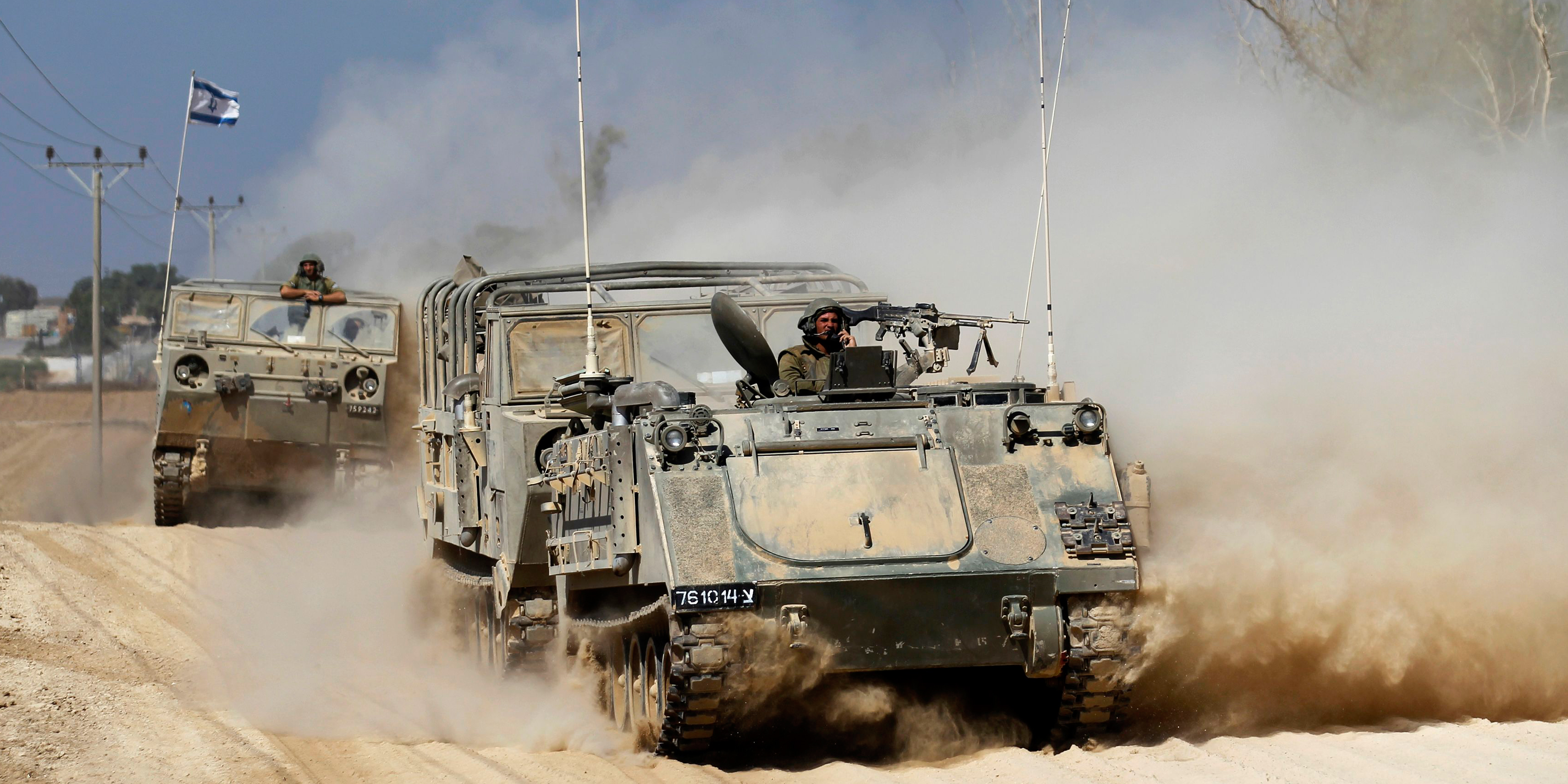 An Israeli armoured personnel carrier (APC) manoeuvres near the border with Gaza Strip August 22. A mortar bomb fired from Gaza killed a four-year-old Israeli boy, in a border collective farm on Friday, Israeli security sources said, the first Israeli child killed in the conflict. Photo: Reuters
