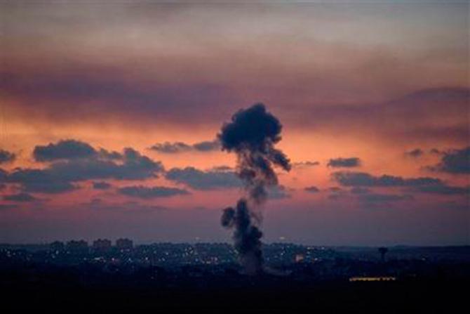 Smoke rises following an Israeli strike on Gaza, as seen from the Israel-Gaza Border, Tuesday, July 8. Photo: AP