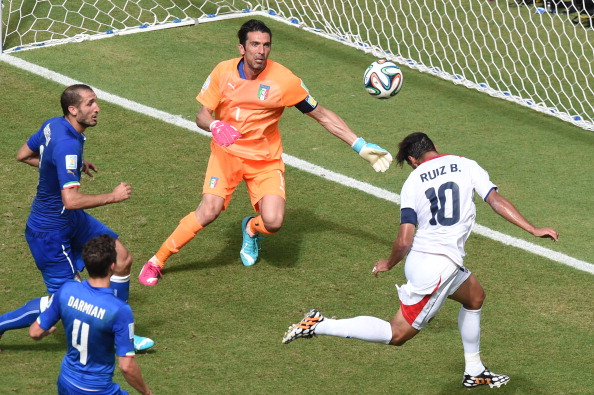 Costa Rica's forward Bryan Ruiz (R) heads the ball to score as Italy's goalkeeper Gianluigi Buffon (2nd R) looks on during a Group D football match between Italy and Costa Rica at the Pernambuco Arena in Recife during the 2014 FIFA World Cup on June 20, 2014. Photo: Getty Images