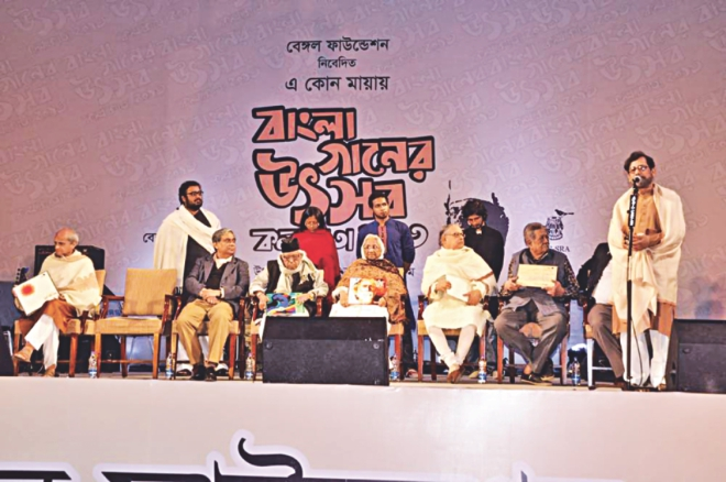 On the lawns of ITC-SRA (the heart of pure classical music in India) a galaxy of artistes, scholars and leading personalities of Bangladesh and India assembled under a huge blue arched canopy resembling an open sky. The occasion marked the first time roster of eminent artistes who had gathered to celebrate the glory of Bangla songs on such a grand scale.