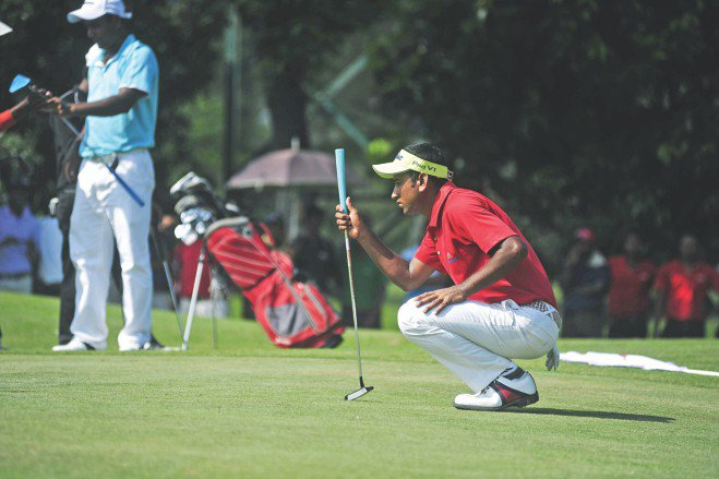 Jamal Hossain Mollah is a picture of concentration as he eyes the target before a putter. PHOTO: STAR File