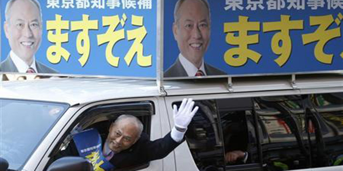 Japan's former health minister and candidate of Tokyo gubernatorial election Yoichi Masuzoe waves to voters from a van, while campaigning for the February 9 vote in Tokyo January 23. Photo: Reuters