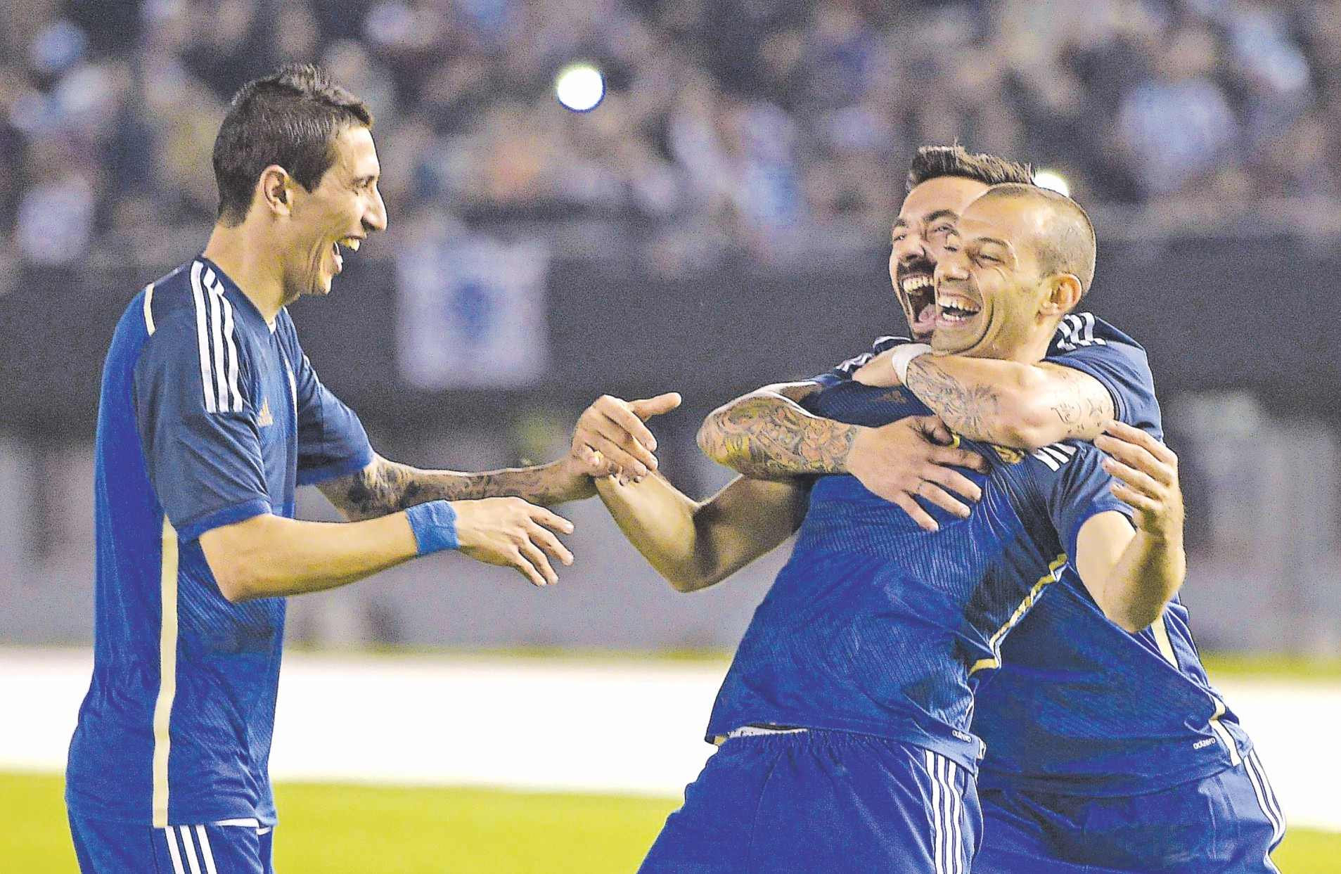Argentina midfielder Javier Mascherano (C) celebrates his goal with teammates Ezequiel Lavezzi and Angel Di Maria (L) during their international friendly  against Trinidad and Tobago at the Monumental Stadium in Buenos Aires on Wednesday. PHOTO:  AFP