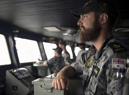 Leading Seaman Luke Horsburgh stands watch during his duty as Quartermaster on the bridge of the Australian Navy ship HMAS Success after it arrived in the search area for missing Malaysian Airlines flight MH370 in this picture released by the Australian Defence Force on March 23.Photo: Reuters