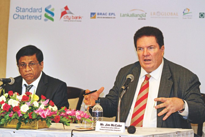 Jim McCabe, CEO of Standard Chartered Bangladesh, speaks at a press conference yesterday to announce Bangladesh Investment Summit to be held in Singapore. Sohail RK Hussain, CEO of City Bank, is also seen. Photo: Star