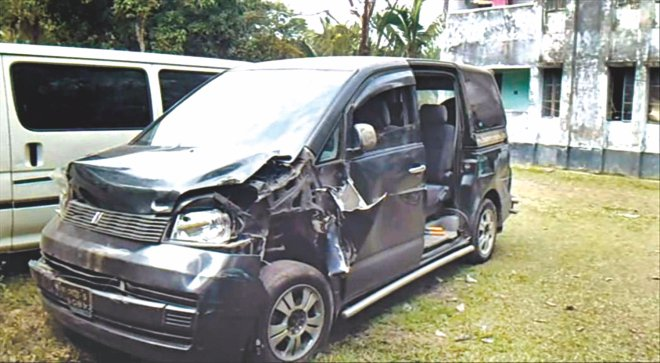 The police have seized this black microbus, which they suspect was used for taking away the convicts.  Photo: Banglar Chokh/Star