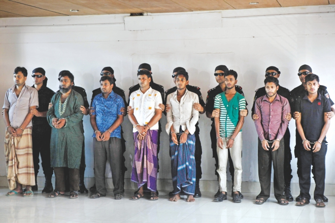 Eight persons arrested in connection with the February Trishal ambush to free three convicted militants are paraded before the media at Uttara Rab headquarters yesterday.   Photo: Star