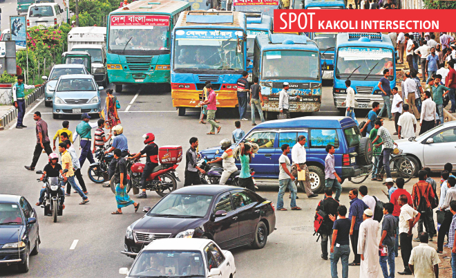 Cars and bikes, from the right side of the intersection, move ahead even though a traffic policeman signals them to wait. The photo was taken at the capital's Kakoli around 6:00pm yesterday.     Photo: Sk Enamul Haq