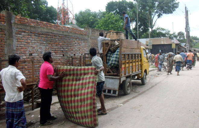 Belongings of a resident of Kandapara brothel in Tangail town being taken on a truck on July 16, 2014 as local influential people forced around 1,500 sex workers to leave the 200-year-old red light area the night before. Star file photo
