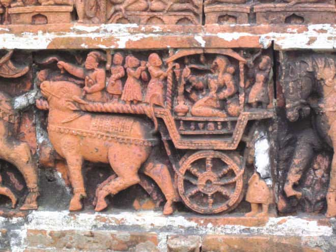 According to terracotta expert Dr Niru Samsunnahar, this  panel of Kantaji Temple illustrates a courtesan travelling  by ox cart. She would have been witty, talented and wise. Photo: Andrew Eagle