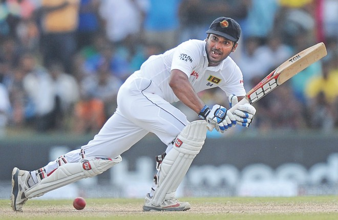 Sri Lanka's master batsman Kumar Sangakkara works the ball on the on side on the fourth day of the first Test against South Africa at the Galle International Stadium on Saturday. PHOTO: AFP