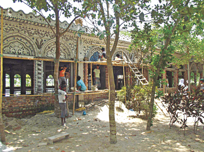 Workers repair Keramatia Jame Masjid, a heritage mosque just beside the border at Barakhata in Hatibandha upazila under Lalmonirhat district, as Indian Border Security Force on May 15 withdrew their objection to the work, after long 10 years.   PHOTO: STAR