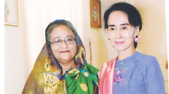 Prime Minister Sheikh Hasina shakes hands with Myanmar opposition leader Aung San Suu Kyi at the latter's parliament office in Naypyidaw, the country's capital, yesterday. The Bangladesh leader is now in the neighbouring Myanmar to attend the third summit of the Bimstec, a regional body of some countries in South Asia and South East Asia, today. Photo: PID