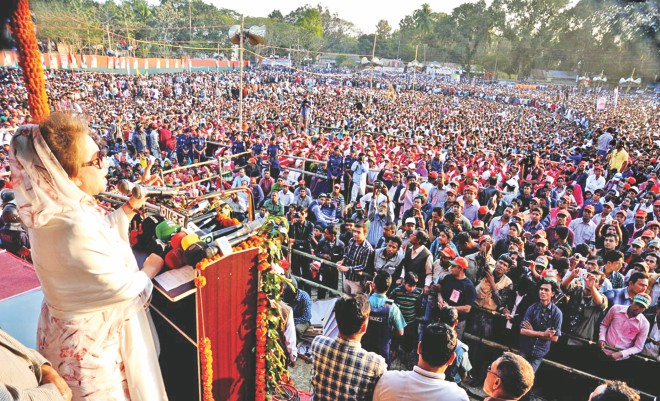 BNP Chairperson Khaleda Zia addresses a 19-party alliance rally on Shaheed Abdul Aziz Khushi Railway Maidan in Rajbari yesterday. This was the BNP chairperson's first public meeting outside the capital since the January 5 general election which was boycotted by the alliance. Photo: Star