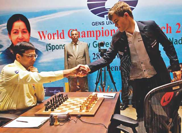 Carlsen (right) beats defending champion Viswanathan Anand.
