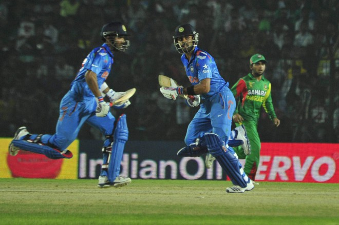 India captain Virat Kohli (C) led his side from the front as did Mushfiqur Rahim for Bangladesh in their Asia Cup opener at Fatullah yesterday. However, Kohli's 136 overshadowed Mushfiqur's 117 as India cruised to a six-wicket win. Photo: Firoz Ahmed