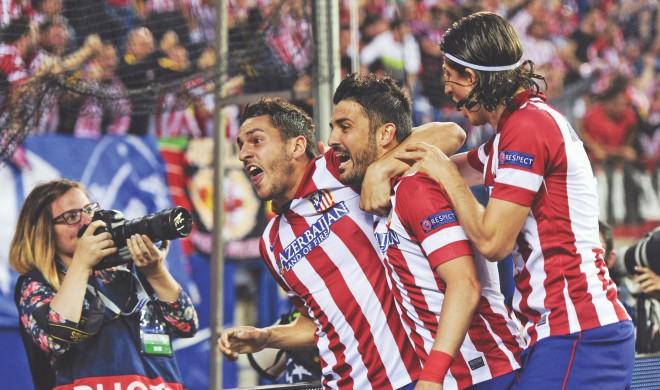 Atletico Madrid midfielder Koke (L) celebrates his all-important goal with teammates David Villa (C) and Filipe Luis during their Champions League quarterfinal at the Vicente Calderon Stadium on Wednesday. Photo: AFP