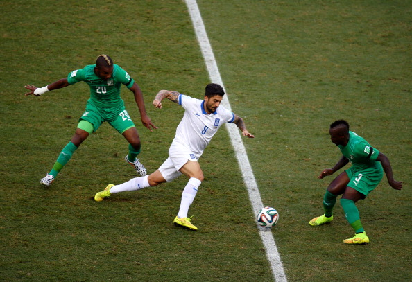 Panagiotis Kone of Greece is challenged by Die Serey (L) and Arthur Boka of the Ivory Coast during the 2014 FIFA World Cup Brazil Group C match between Greece and the Ivory Coast at Castelao on June 24, 2014 in Fortaleza, Brazil. Photo: Getty Images