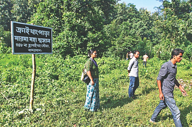 A signboard marks Krykhyongpara cremation ground which falls within the land that the BGB has fenced to build its Bandarban headquarters.  Photo: Anurup Kanti Das