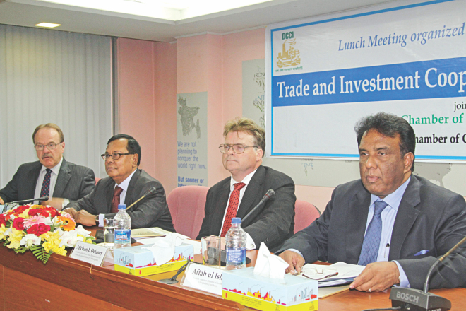 From left, Dan Mozena, US ambassador; Shahjahan Khan, president of DCCI; Michael Delaney, US assistant trade representative, and Aftab ul-Islam, president of AmCham, attend a discussion on Ticfa, in Dhaka yesterday. Photo: Star