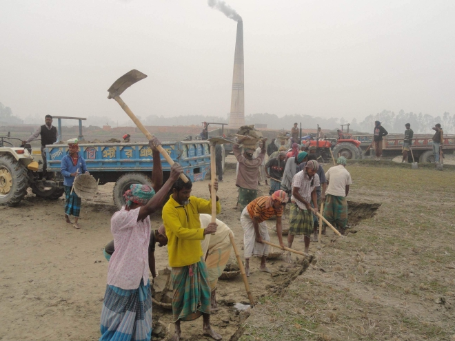 Labourers employed by a brick kiln owner at Modonerchak village in Lalmonirhat Sadar upazila dig up the topsoil for making bricks. The areas around almost all the brickfields in the district give similar images as the authorities concerned are turning a  blind eye to the callous act, badly affecting the fertility of farmlands.  PHOTO: STAR