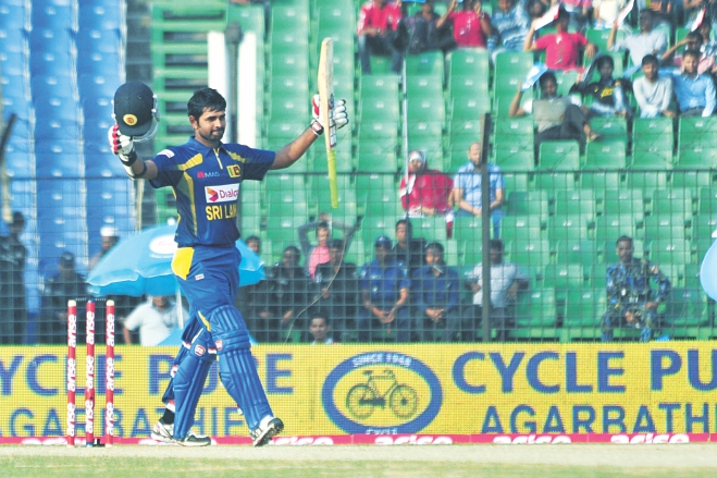 Sri Lanka batsman Lahiru Thirimanne raises his bat on reaching his century against Pakistan in the Asia Cup opener at the Khan Shaheb Osman Ali Stadium in Fatullah yesterday. PHOTO: STAR