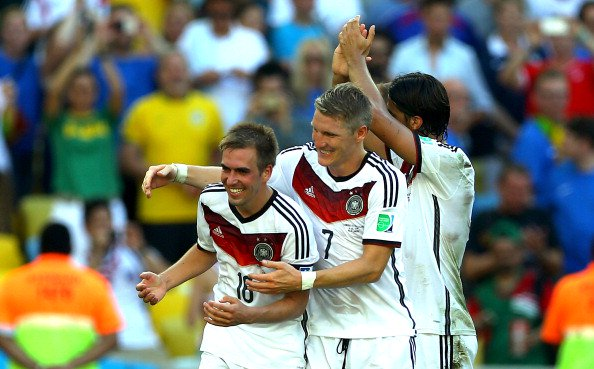 Bastian Schweinsteiger and Benedikt Hoewedes and Philipp Lahm of Germany celebrate after the 2014 FIFA World Cup Brazil Quarter Final match between France and Germany at Maracana on July 4, 2014 in Rio de Janeiro, Brazil. Photo: Getty Images