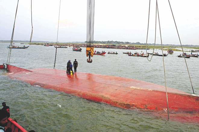 A rescue vessel trying to pull the capsized launch MV Miraj-4 towards the shore of the Meghna in Munshiganj yesterday.  Photo: Star
