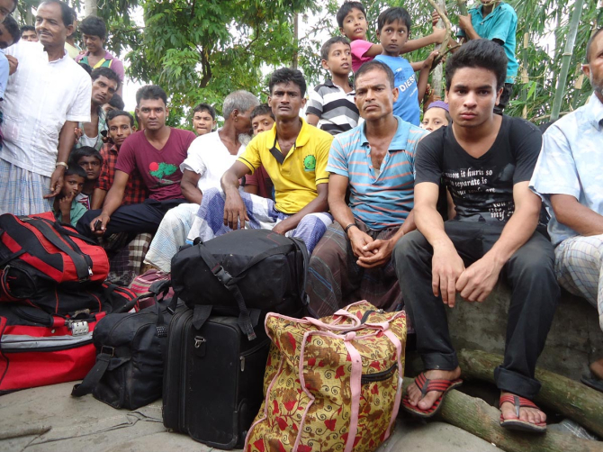 ORDEAL OF HOME-BOUND PEOPLE: Above, passengers wait for alternative transport after their evacuation from the Karnaphuli-1 launch at Kaliganj in Mehandiganj upazila under Barisal district yesterday. PHOTO: STAR
