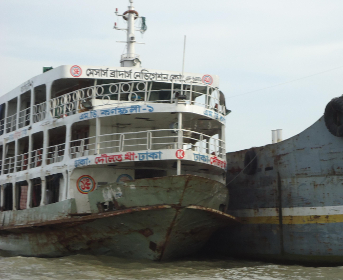 This 800-passenger-capacity launch MV Karnaphuli-1, overloaded with around 2,500 people, developed cracks at the bottom in mid-Meghna in Mehendiganj upazila under Barisal district yesterday, forcing its anchoring at a terminal at Kaliganj in the upazila and evacuation of the people on board. PHOTO: STAR