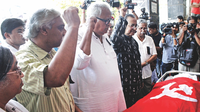 Leaders of the Communist Party of Bangladesh salute the coffin of scholar and philosopher Sardar Fazlul Karim at the party office in the capital yesterday. Sardar died early yesterday. Photo: Banglar Chokh