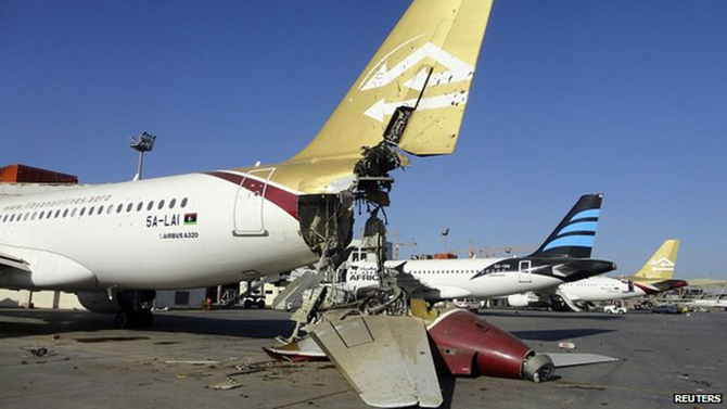 Damaged plane at Tripoli airport. 25 Aug 2014 Planes and buildings have been badly damaged by fighting at the airport