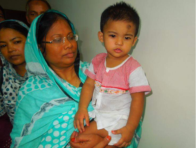 Little Junayed Hasan, abducted for ransom in Nilphamari, returns to his mother's lap on Thursday night. PHOTO: STAR