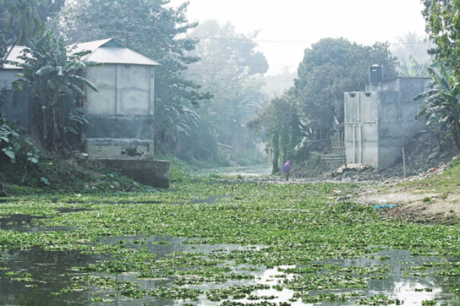 Structures built through occupying the river Louhajang in Akur Takur Para in Tangail. Photo: Mirza Shakil