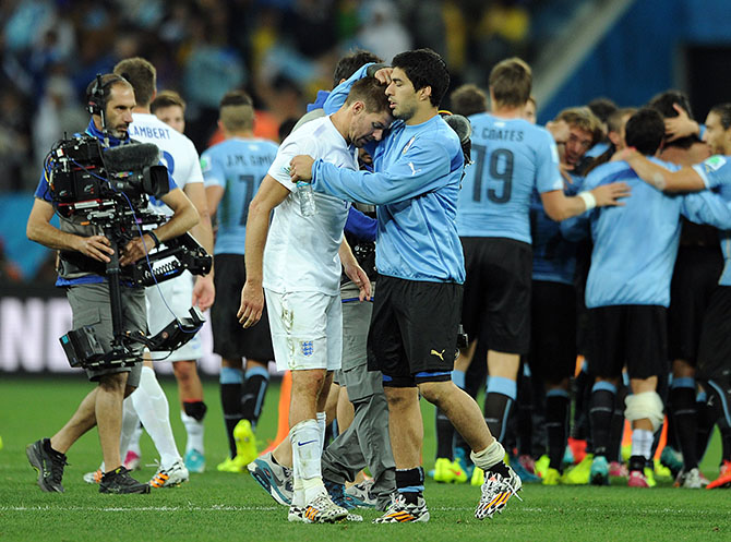 Luis Suarez of Uruguay consoles Steven Gerrard of England following the 2014 FIFA World Cup Brazil Group B match between Uruguay and England at Arena de Sao Paulo on June 19, 2014 in Sao Paulo, Brazil. Photo: Getty Images