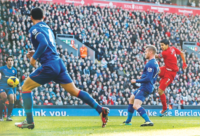 Liverpool striker Luis Suarez (R) scores one of his two goals against Cardiff City during their Premier League encounter at Anfield yesterday. Photo: Reuters