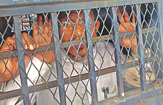 Former state minister for home Lutfozzaman Babar in the prison van in front of the Chittagong court building after he was sentenced to death yesterday for his involvement in the smuggling of 10 truckloads of arms and ammo in 2004. Photo: Anurup Kanti Das