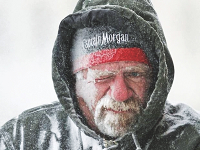 A man braves the bitter cold. Photo: AFP