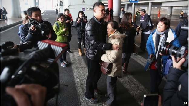 A relative of a passenger at Beijing International Airport Relatives gathered at Beijing International Airport fearing the worst