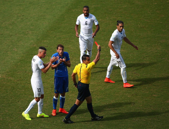 Referee Marco Rodriguez shows a red card to Claudio Marchisio of Italy during the 2014 FIFA World Cup Brazil Group D match between Italy and Uruguay at Estadio das Dunas on June 24, 2014 in Natal, Brazil. Photo: Getty Images