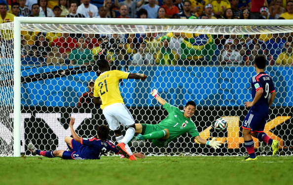 Jackson Martinez of Colombia scores his team's second goal past Eiji Kawashima of Japan during the 2014 FIFA World Cup Brazil Group C match between Japan and Colombia at Arena Pantanal on June 24, 2014 in Cuiaba, Brazil. Photo: Getty Images