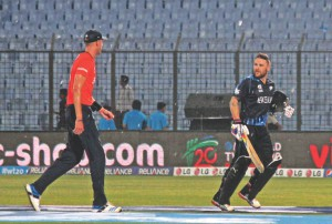 New Zealand captain Brendon McCullum (R) and his England counterpart Stuart Broad head to the dressing rooms. PHOTOs: ANURUP KANTI DAS