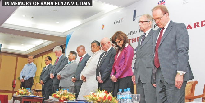 Fifth from right, Khandker Mosharraf Hossain, expatriate welfare and overseas employment minister, and foreign diplomats observe moments of silence in memory of Rana Plaza workers, at a programme at Ruposhi Bangla Hotel in Dhaka yesterday.  Photo: Star
