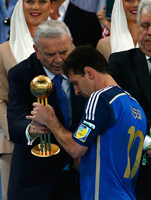 Jose Maria Marin, President of the CBF, presents Lionel Messi of Argentina with the Golden Ball during the 2014 FIFA World Cup Brazil Final match between Germany and Argentina at Maracana on July 13, 2014 in Rio de Janeiro, Brazil. Photo: Getty Images