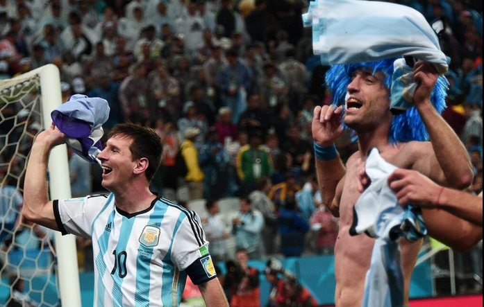 Argentina captain and forward Lionel Messi responds to the crowd after his side qualified for the World Cup final beating the Netherlands 4-2 in the second semi-final.