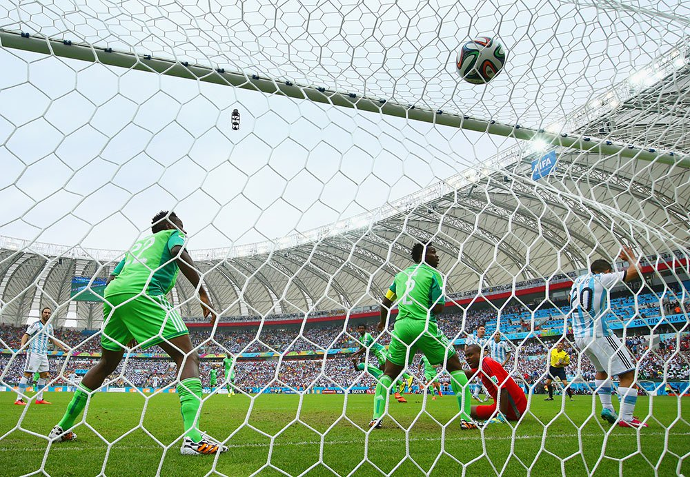 Lionel Messi of Argentina scores his team's first goal past Vincent Enyeama of Nigeria during the 2014 FIFA World Cup Brazil Group F match between Nigeria and Argentina at Estadio Beira-Rio on June 25, 2014 in Porto Alegre, Brazil. Photo: Getty Images
