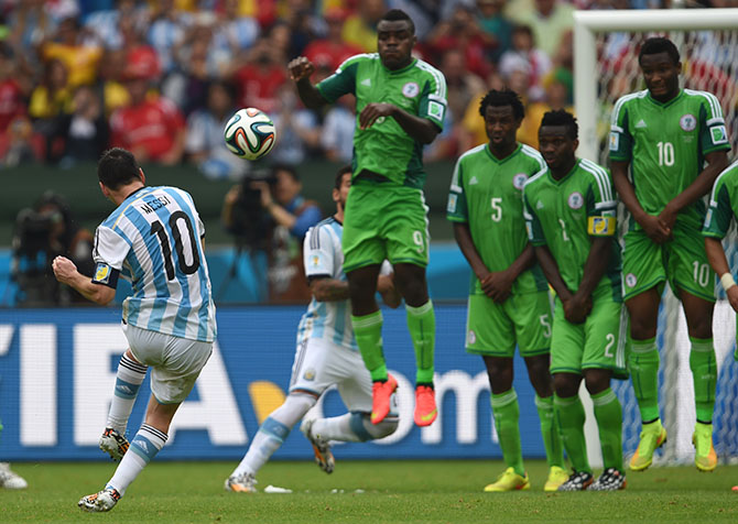 Argentina's Lionel Messi shoots to score his second goal against Nigeria in the Group F football match at the Beira-Rio Stadium in Porto Alegre during the 2014 FIFA World Cup. Photo: Getty Images