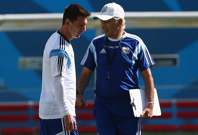 Lionel Messi of Argentina and coach Alejandro Sabella during a training session at Arena de Sao Paulo ahead of their 2014 FIFA World Cup Brazil round of 16 football match against Switzerland. Photo: Getty Images