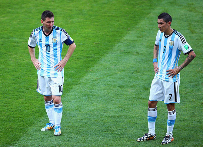 Lionel Messi (L) and Angel di Maria of Argentina look on during the 2014 FIFA World Cup Brazil Group F match between Argentina and Iran. Photo: Getty Images
