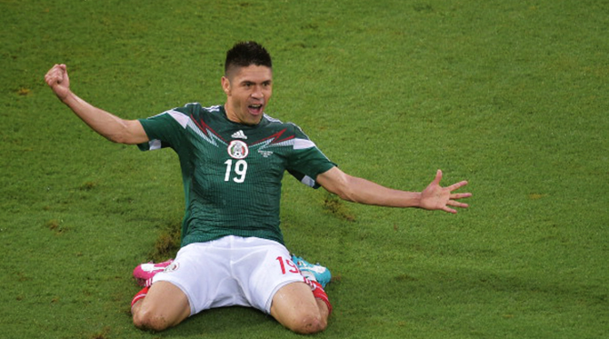 Mexico's forward Oribe Peralta celebrates after scoring a goal during the Group A football match between Mexico and Cameroon at the Dunas Arena in Natal during the 2014 FIFA World Cup on June 13, 2014. Photo: AFP/Getty Images